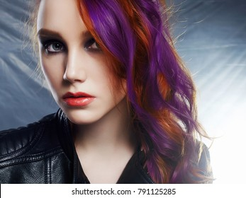 Beautiful young woman portrait with color hair.trendy model girl with make-up and blue locks on hair