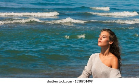 beautiful young woman portrait enjoy in sun and sea air on beach closed eyes relaxing summer day