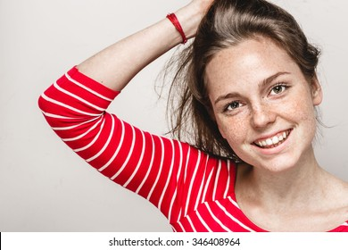 Beautiful young woman portrait freckles smiling posing attractive brunette