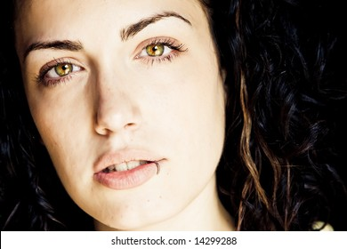 Beautiful young woman portrait with green eyes.