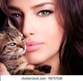 beautiful young woman portrait holding kitten, close up