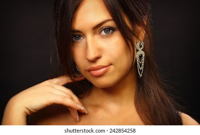 Beautiful young  woman portrait. Jewelry and diamonds