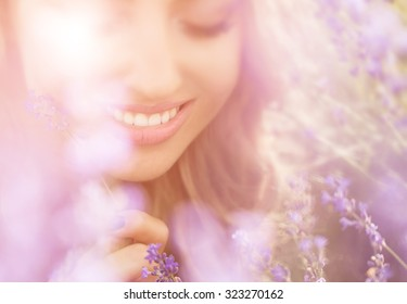 Beautiful young woman portrait in lavender field
