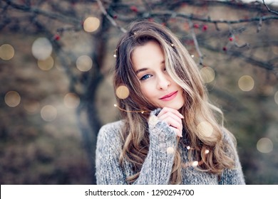 Beautiful young woman portrait in nature with bokeh