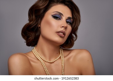 Beautiful Young Woman Portrait with pearl jewellery, necklace. Romantic lady face closeup. Old Fashioned Makeup and Finger Wave Hairstyle