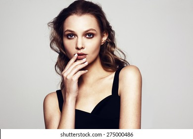 beautiful young woman portrait with professional make up and manicure