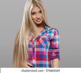Beautiful young woman portrait smiling posing attractive with amazing long blonde hair