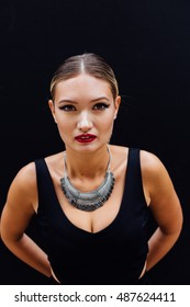 A beautiful young woman poses.