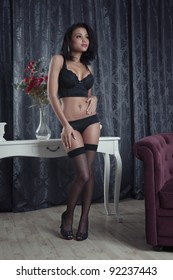 Beautiful young woman posing in black lingerie
