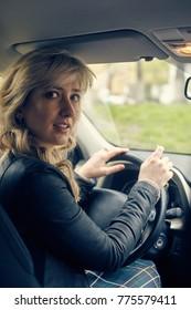 beautiful young woman posing in car window