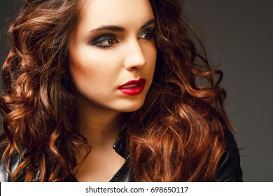 Beautiful young woman posing in leather jacket. Fashion concept.