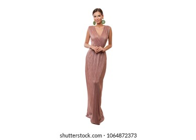 Beautiful young Woman Posing in a light Summer Dress without a handle with a deep neckline, Pink Maxi Dress isolated over a white background with copy  space.