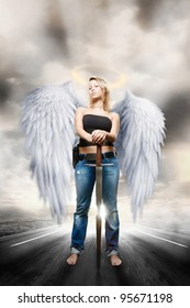 Beautiful young woman posing as majestic angel guardian