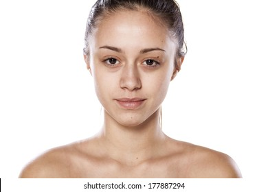 beautiful young woman posing with no makeup on white background