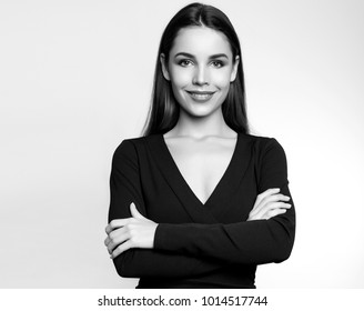 beautiful young woman posing on grey background
