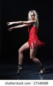 beautiful, young woman posing on studio background