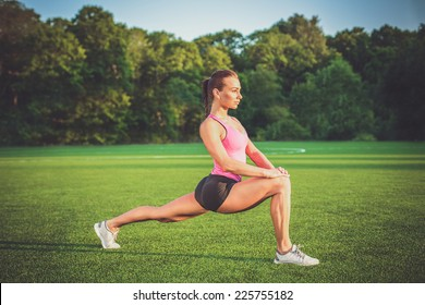 Beautiful young woman practicing or exercising. Woman doing sports outdoor.