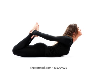 A beautiful young woman practicing Yoga in a Studio.