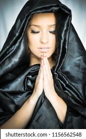 Beautiful young woman in prayer, nun