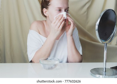 Beautiful young woman is preparing skin for hydrating bubble mask