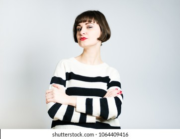 beautiful young woman is proud of herself, short haircut, studio photo on the background