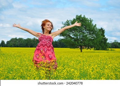 Beautiful young woman in a raps field