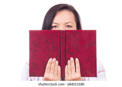 Beautiful Young Woman Reading a Book and Hides His Face on a white background