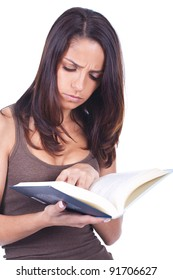 beautiful and young woman reading a book