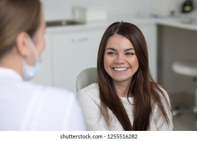 Beautiful young woman at the reception at the dentist.