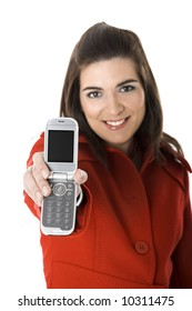 Beautiful young woman with a red coat holding and showing her cell phone