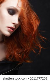 Beautiful young woman. red hair girl with make-up
