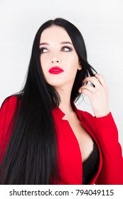 the beautiful young woman in a red jacket in room with white walls