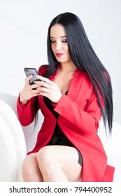 the beautiful young woman in a red jacket with mobile phone