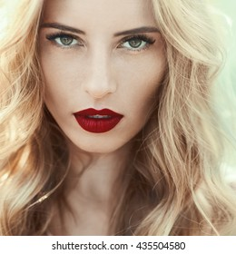 beautiful young woman with red lips closeup