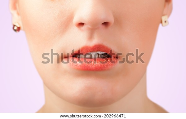 Beautiful young woman red lips close up