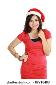 Beautiful young woman in red wearing santa hat. Isolated on white background.
