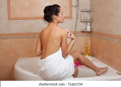 Beautiful young woman relaxing in a bathroom.