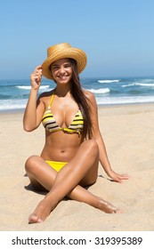 Beautiful young woman relaxing at the beach