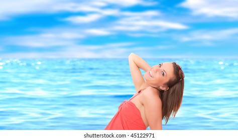 Beautiful young woman relaxing by the beach in Greece