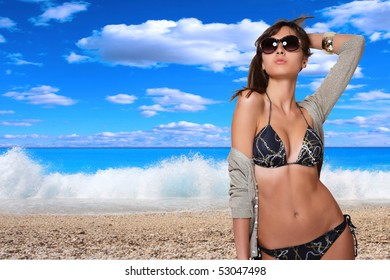Beautiful young woman relaxing by the sea
