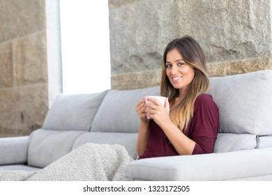 Beautiful young woman relaxing at home