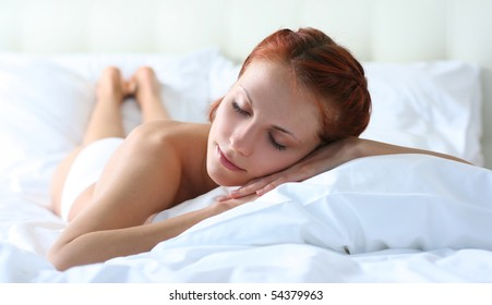 beautiful young woman relaxing on bed