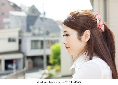 Beautiful young woman relaxing outdoor