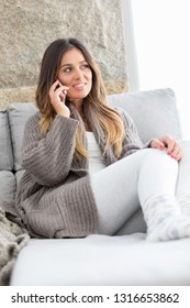 Beautiful young woman relaxing at the phone