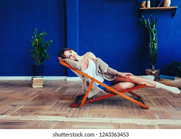 beautiful young woman resting in the chair