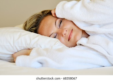 Beautiful young woman resting in her bed