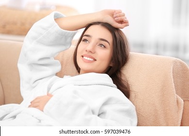 Beautiful young woman resting in spa salon