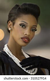 Beautiful young woman with retro vintage short hairstyle
