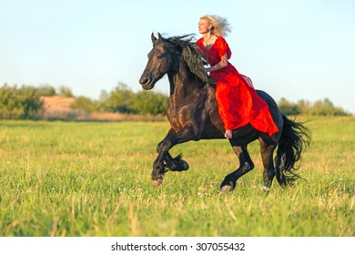 Beautiful young woman riding free horse. Bareback and with no bridle.