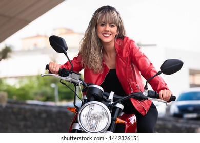 Beautiful young woman riding on motorcycle